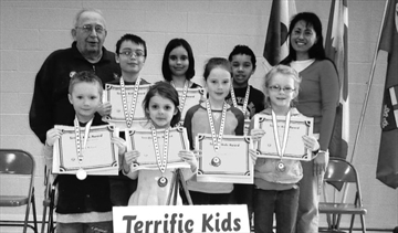 St. Peter Catholic School, March 14. Front - Horatio, Kalleigh, Loren, Kaylee. Back - John Blasko, Thomas, Allison, Tristan, school principal Jacqueline Gauthier.