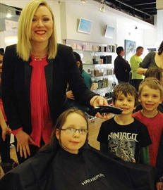 Hair Republic stylist Michelle Nguyen, left, will offer 100 slots for the Hair with Care fundraiser organized by Anneka O'Grady, seated. Schoolmate JeffZamuner and her brother Bryan will participate in the kids-only event.