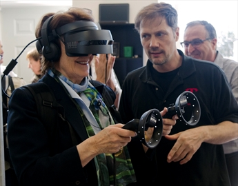 Lincoln Mayor Sandra Easton tries out a virtual reality system created by TReality. The startup utilized services from Spark Niagara to get connected with other larger technology companies. Spark Niagara launched its Beamsville location on Monday.