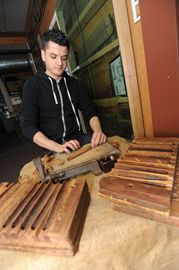 Kris Miller works on a cigar at the Frank Correnti Cigar factory.