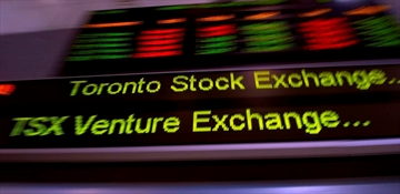 The TSX ticker is shown in Toronto on May 10, 2013. THE CANADIAN PRESS/Frank Gunn