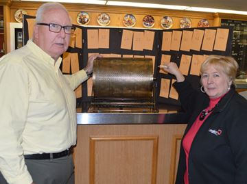 Murray Green from the Ancaster AM Rotary Club and Mountain Legion president Shirley Beaton with the Catch the Ace lottery drum that gets rolled each Thursday.
