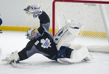 James Reimer makes a save during the Toronto Maple Leafs' outdoor practice at Greenwood Rink Feb. 21.
