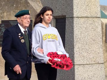 Isabel Savoia helps D-Day veteran Cyril Crane lay at wreath at the Queen's Own Rifles monument on Juno Beach.
