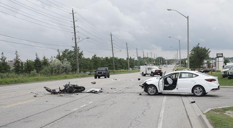 Crash involving motorcycle closes section of Woodlawn Road