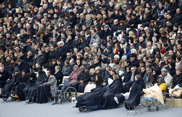 France honours attack victims in city subdued by mourning-Image1