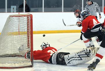 Stouffville's Ryan Smith fires the puck over fallen Keswick goalie Keith Mingo, scoring SDSS's first goal.