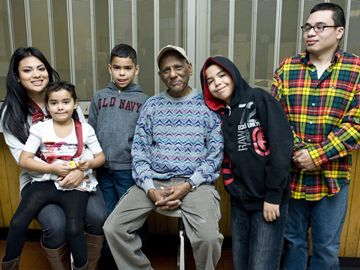 "Ram Ramchaitar, surrounded by some of his grandchildren and great grandchildren (from left) Janice, Julissa, James, Jaiden, and Joseph, said helping out at the Parkdale Breakfast Club shows the volunteers that all humans are beautiful people. Ram and his wife started the club in 1989 after seeing a need in their community. ""They take away from the experience how to deal with people who don't have much and how to serve people who have very little and who have problems in life,"" he said."