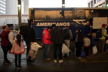 A group of asylum seekers wait to board a bus after being released by border patrol agents, in San Antonio, Texas, April 2, 2019. President Donald Trump said Friday he was open to releasing migrants detained at the border into mostly Democratic 'sanctuary cities,' suggesting that the idea should make liberals 'very happy' because of their immigration policies.