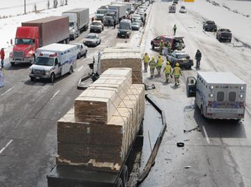 Guardrails gave way near County Road 89 on Highway 400 as a southbound tractor-trailer carrying lumber smashed into a cube truck March 5, sending it through the guardrail and into the path of a northbound minivan.
