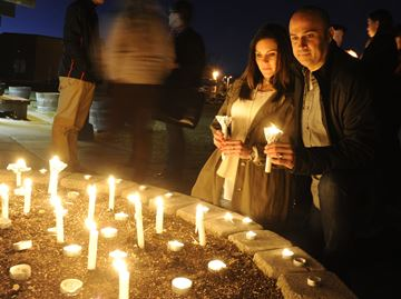 Candleight vigil attracts 60 for former Burlington resident on trial