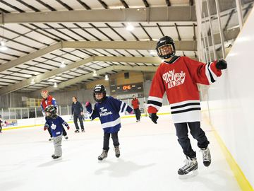 OSHAWA -- Brent Crocker, right, and his sister Emma Crocker, middle, skated as residents, sport user groups and City officials celebrated the official re-opening of Harman Park Arena. The free open house event featured two free leisure skating times as well as off-ice activities. November 29, 2013.