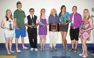 Midland Secondary School teacher Holly Millinoff, fourth from right, winner of the Jeff Attwood Coaching Excellence Award, poses with the junior and senior male and female athletes of the year.