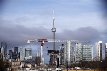 The CN Tower can be seen in the Toronto skyline in Toronto, Ontario on Tuesday, April 25, 2017. Chambers of commerce from Canada's biggest cities will release a campaign wish list Wednesday urging political parties to commit to establishing national data-governance standards, making government research more available for businesses and fully harnessing the value of intellectual property. THE CANADIAN PRESS/Cole Burston
