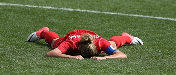 Christine Sinclair drops to the field at the final whistle as Canada wins the bronze medal beating  France 1-0 inthe bronze medal soccer match at the London 2012 Olympic Games at the Coventry Stadium in Coventry.  August 9, 2012