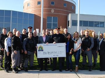 Halton police raise $19,000 for Autism Ontario