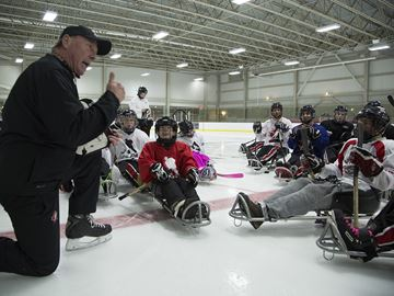 National team shares tips with local sledge hockey players