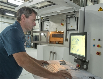 Photo of Peter Adams, Burloak Engineered Solutions with the 3-D imaging printer