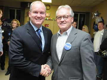 CLARINGTON -- Long-serving Durham MPP John O'Toole (right) announced Friday, Feb. 28 that he will be retiring and not seeking re-election. Here he congratulates his son Erin O'Toole after being elected MP ofr Durham riding in November 2012