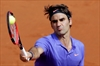 Federer, Sharapova advance at French Open-Image1
