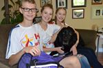 Lisle teen's service dog retires working vest