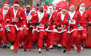Santas start their run down Brant Street during  the largest Santa race in Canada.