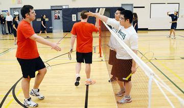 St Elizabeth Panthers Daniel Vasic (left) and Alexander Lima shake hands with Newmarket Raiders Andrew Hu and Kevin Kim, who won the match 21-10 and 24-22.