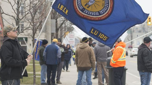 Workers protest Bill 70 outside of Oakville MPP Kevin Flynn's office