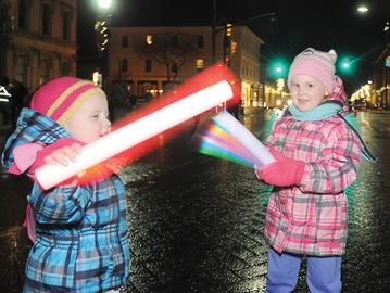 COBOURG -- Sisters Chace Hunt, 2, left, and Haden McKinnon, 3, enjoyed a glow stick sword fight before the light up of Victoria Hall on Nov. 22 during Cobourg's Christmas Magic Lighting Up Ceremony. November 22, 2013.