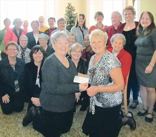 Arnprior and District Breast Cancer Support Group representative Karen Corbin, right, presents a $2,000 donation to Hospice Renfrew. Accepting the money is Connie Legg of Hospice Renfrew, a residential hospice that serves Renfrew, Arnprior and the region.