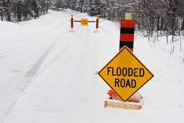 Residents on Huntsville's Old North Road woke up to three inches of snow on April 15 and a flooded road.