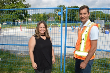 Centremount neighbourhood association president Holly Chriss with city landscape architect Ken Wheaton in front of the new splash pad at Bruce Park that is nearly completed.