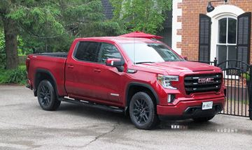 GMC's new Elevation sub-brand (Sierra model shown) eliminates the bling for body-colour bumpers, premium interiors and blacked out trim to try and attract younger buyers to GM's all-truck brand.