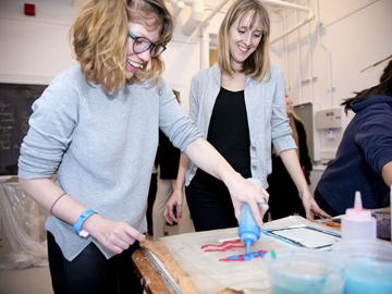 Claire Orange, left, and Jessica Wilson make paper at the Paperhouse Studio.