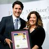 Laurie Higgins receives award from Justin Trudeau