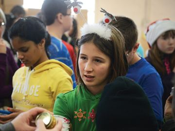 OSHAWA -- Grade 6 student Teagan Schuck, from St. Bridget Catholic School in Brooklin, helped sort food donations with her classmates at Simcoe Hall Settlement House. They raised money by pledging to turn off their TVs for a week and then bought toys and food for families in need. December 16, 2013