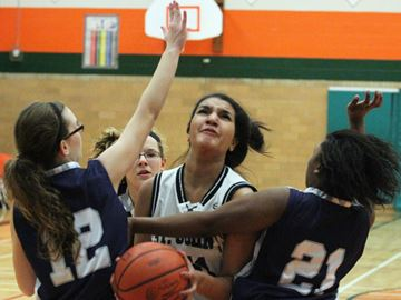 SJC Green Eagles player Kayla Gaucher gets fouled by a crowd of Jacob Hespeler Hawks players during the junior CWOSSA championship game at North Park Collegiate on Saturday.