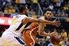 After Huggins' scary moment, No. 12 WVU beats Texas 77-62-Image4