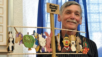 Nepean resident Thomas Fillion brought woodcut ornaments and other Touched By Wood crafts to city hall on Nov. 28. Fillion and other seniors were invited to sell their handmade wares at a craft sale in Jean Pigott Hall.