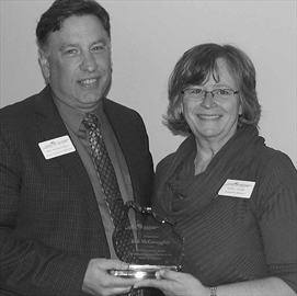 Western Ottawa Community Resource Centre (WOCRC) executive director Cathy Jordan, right, presents the Eva James Award to recipient Bob McGaraughty, left, at the WOCRC annual volunteer appreciation breakfast at the NEXT Restaurant in Stittsville last Friday.