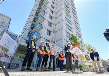 Adam Vaughan, parliamentary secretary to the minister of families, children and social development, makes a funding announcement in front of 500 MacNab St N.