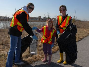 Aunt Danielle Gifford (left), along with Trinity and her mom Nicole Gifford help out at the Bradford Community Clean Up Saturday, April 12.