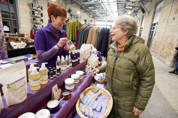 Carolyn Koprich of Purple Daze Lavender tells Merle Gould about her products during the Made in Canada Show at Artscape Wychwood Barns Sunday afternoon. (Dec. 15, 2013)