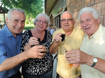 Joe and Rose Sunseri join with Vince Votta and Vito Bartucca in raising a toast to the long weekend.