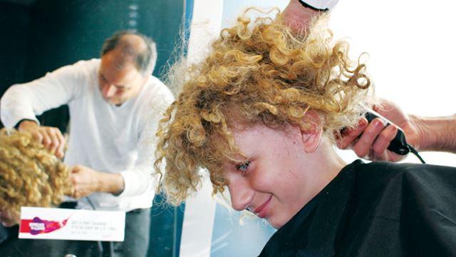 Georgetown boy cuts hair for CAShh fundraiser