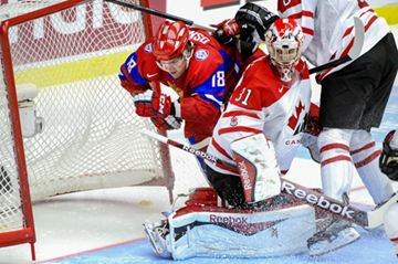 Russia's Vyacheslav Osnovin, left, is checked into the net behind Canada's goalie Zachary Fucale during the World Junior Hockey Championships bronze match between Canada and Russia at Malmo Arena in Malmo, Sweden, Sunday.