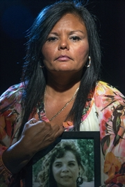 Chastity Martin with a photo of her aunt, Paula Joy Hill, one of Six Nations' missing and murdered Indigenous women. Hill was stabbed to death by her husband in 1996.