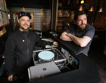 Co-owners Jonathan Hall, left, and Mike Judson take a break inside their new bar Twisted Wheel on Thursday May 3, 2018 on Water Street. Mr. Hall died Friday, March 22, 2019.