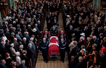 Belanger's gender neutral anthem sung at funeral-Image1