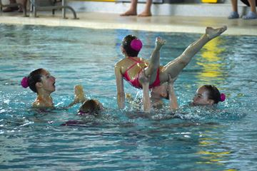 DANCING IN WATER: Synchronized swimmers competed at the Bracebridge Sportsplex during the Ontario Winter Games to a full audience. (Photo by Jennifer Bowman)